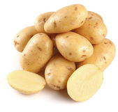Yellow potatoes with section on a white background — Stock Photo