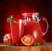 Jug and glass full of tomato juice. — Stock Photo