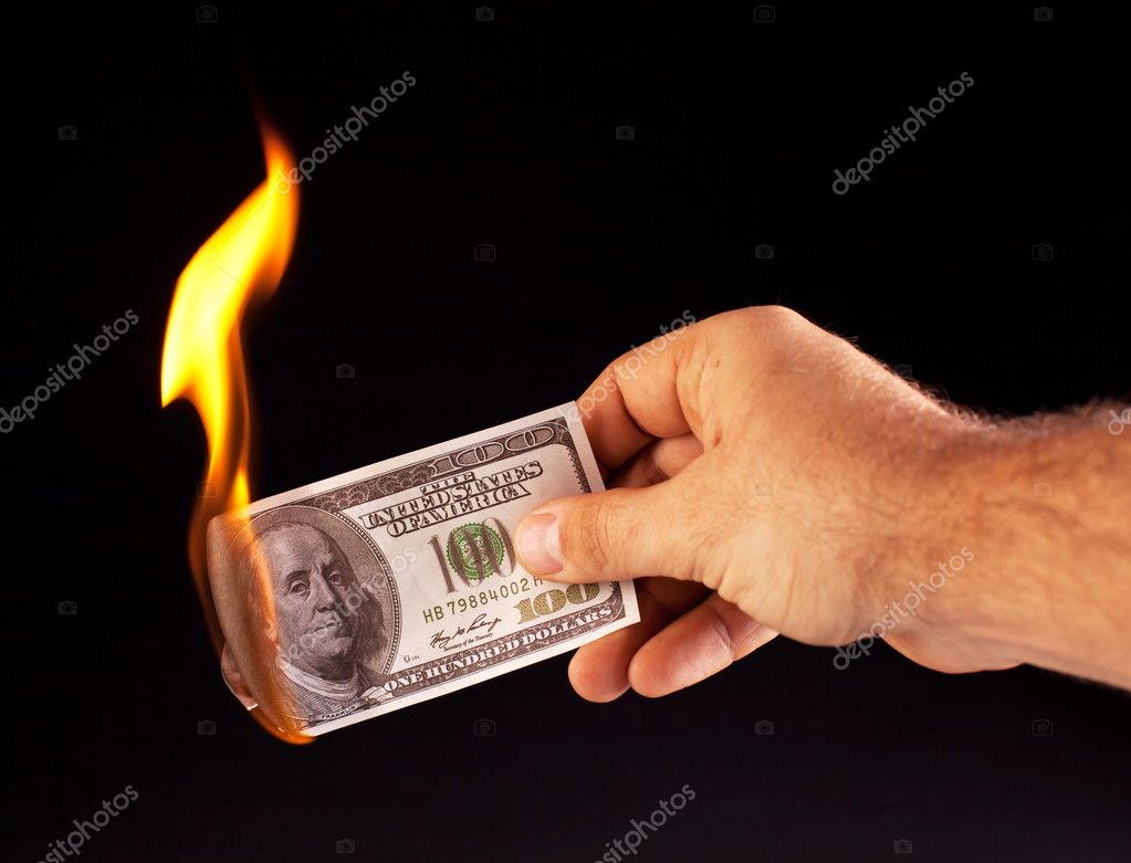 Burning dollar in hand isolated on a black — Stock Photo #4517836