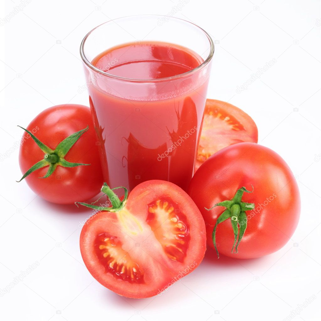 Full glass of fresh tomato juice and vegetables near it.  Stock Photo #4519031