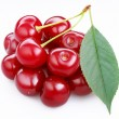 Group ripe cherries with a leaf on a white background. — Стоковая фотография