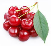 Group ripe cherries with a leaf on a white background. — 图库照片