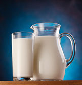 Glass and jar of milk. photo. — Stock Photo