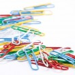 Group of colored paper clips. Isolated on a white background. -  