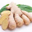 Fresh ginger with leaves isolated on white background. — Stock Photo