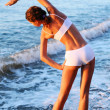 Sexy brunette is running on the beach — ストック写真 #5005765