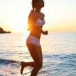 Sexy brunette is running on the beach — Stock Photo #5005793
