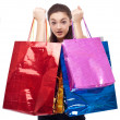Happy girl with shopping bags. Isolated on a white background — Stock Photo