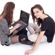 Two teenager with laptop. Modern life. - Stock Photo