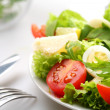 Salad with tomatoes and quail egg — Stock Photo