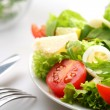 Salad with tomatoes and quail egg — Stock Photo #5007684