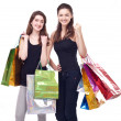 Girl with shopping bags on a white background. — Stockfoto