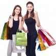 Girl with shopping bags on a white background. — Foto Stock