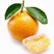 Image of a ripe tangerine with leaves on white background. — Stock Photo #5007991