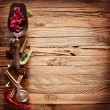 Image texture of old wooden boards with kitchen spices. - Stockfoto