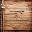 Stock Photo: Image of old texture of wooden boards with ship rope.