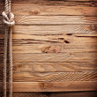 Image of old texture of wooden boards with ship rope. — Стоковая фотография