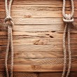 Photo: Image of old texture of wooden boards with ship rope.