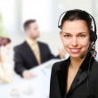 Customer support operator woman smiling at an office — Stock Photo #5009907