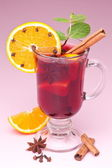 Glass of mulled wine on a pink background — Stock Photo