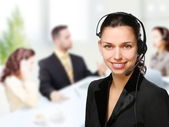 Customer support operator woman smiling at an office — Stok fotoğraf