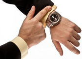 Man's hand in the suit pointing on his watch — Photo