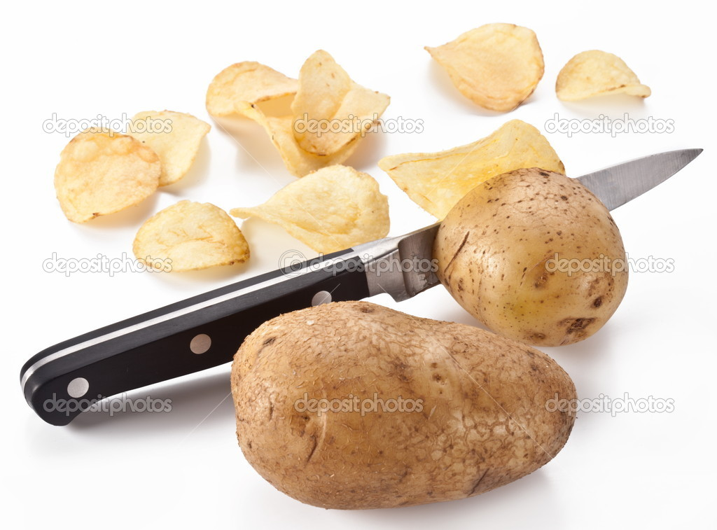 Conceptual image - the knife cuts fresh potatoes and potato chips are obtained. — Stock Photo #5003411