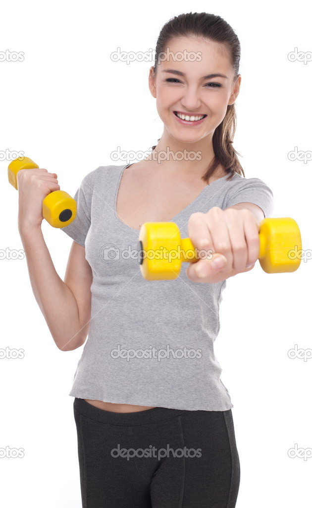 Young girl lifting barbells on a white background  — Stock Photo #5005575