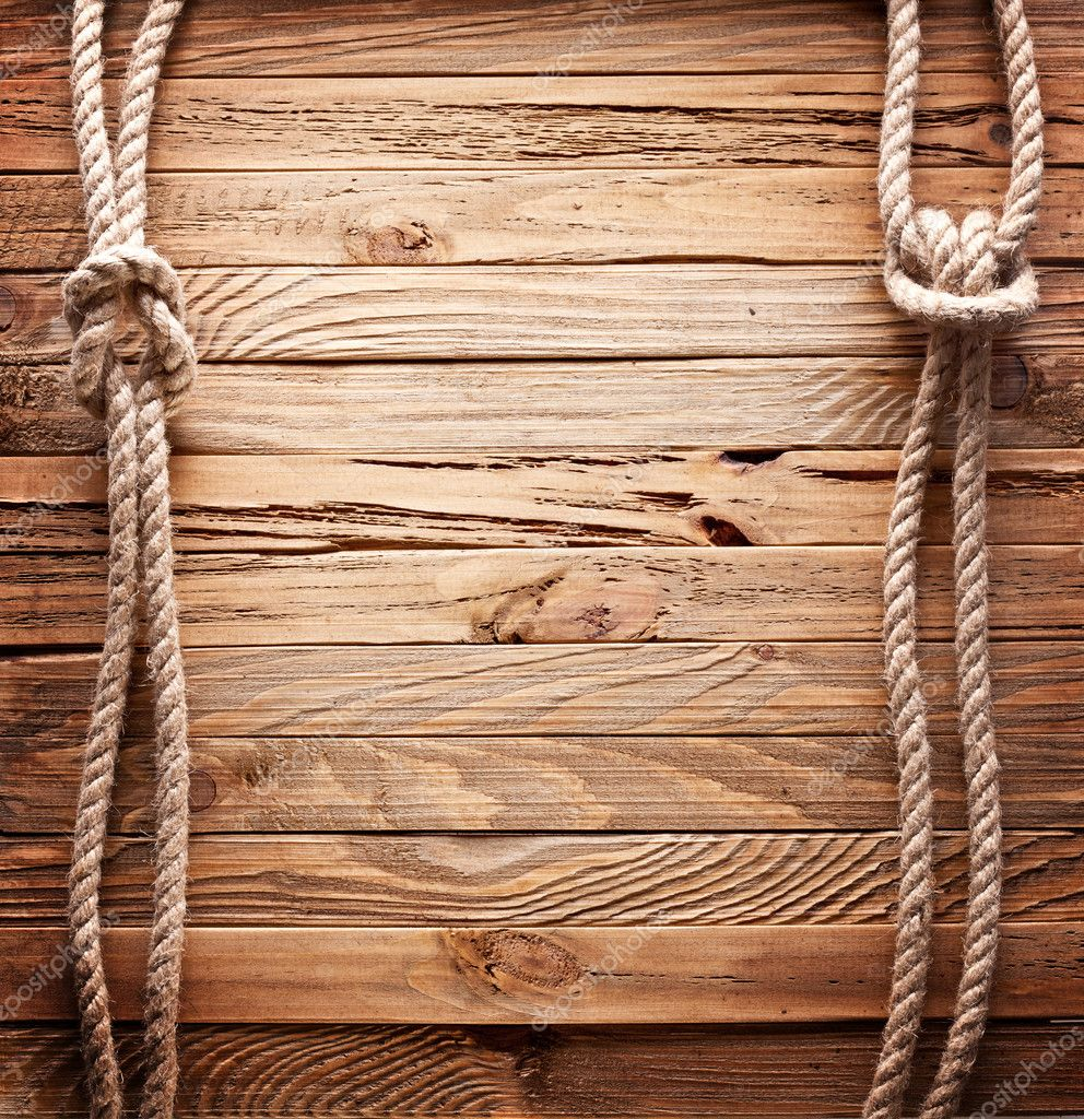 Image of old texture of wooden boards with ship rope.  Stock Photo #5009074
