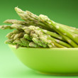 Stock Photo: Sheaf of asparagus on green background.