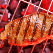 Photo: Hot beefsteak on barbecue