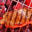 Стоковое фото: Hot beefsteak on barbecue