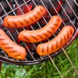Stock Photo: Hot sausages on barbecue