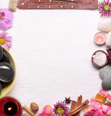Frame made from spa accessories over white towel. — Stock Photo