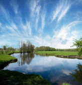 Lake in countryside in the spring time. — Stock fotografie