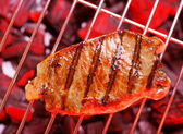 Hot beefsteak on barbecue — Foto Stock