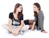 Two friends talking to each other. The image is isolated on a wh — Stock Photo