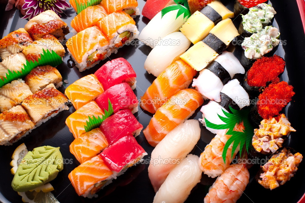 Assorted japanese sushi on a black plate. — Stock Photo #5348599