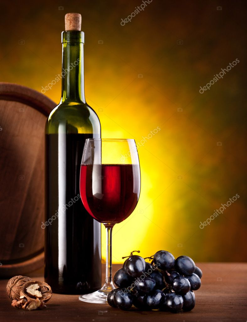 Still life with wine bottle, glass and oak barrels. — Stock Photo #5349300