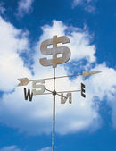 Weather vane and blue sky — Stock Photo