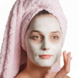 Stock Photo: Beautiful girl in rejuvenating mask with towel