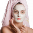 Girl in a rejuvenating mask with towel on your hair — Stock Photo