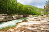 Stormy river with stone banks — Stock Photo