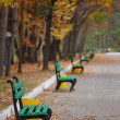 Stock Photo: Wonderful green bench in the park