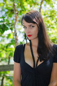Beautiful girl on a park bench 4 — Stockfoto