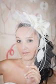 Mysterious bride in an elegant white dress — Stock Photo
