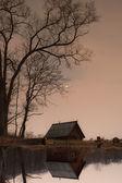 Wonderful reflection of the ramshackle hut — Stock Photo