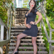Brunette girl on the stairs in the park — Stock Photo #4383822