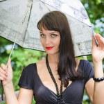 Young sexy girl under the umbrella — Stock Photo #4383901