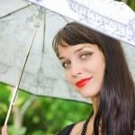 Young sexy girl under the umbrella — Stock Photo #4383906